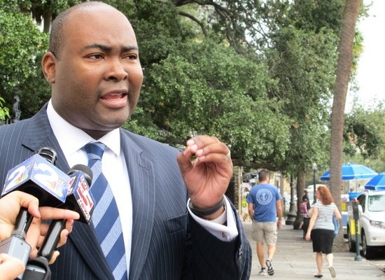 CORRECTS TO ALMOST A YEAR, NOT THE ANNIVERSARY, IN FIRST SENTENCE - South Carolina Democratic Party Chairman Jamie Harrison speaks with reporters in downtown Charleston, S.C., on Monday, Oct. 21, 2013, about a year after the announcement of the hacking of the tax returns of millions of South Carolinians. Harrison called the handling of the situation a failure of leadership by Republican Gov. Nikki Haley. Haley spokesman Doug Mayer responded that the governor's focus from the start has been on tracking down the hacker and that while technology always evolves, South Carolinians are far safer from such attacks than they were a year ago. (AP Photo/Bruce Smith)