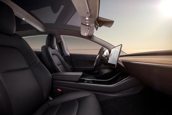 model-3-interior-console-cupholder-dash.jpg