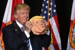 SARASOTA, FL - NOVEMBER 07: Republican presidential nominee Donald Trump holds up a rubber mask of his face during a campaign rally in the Robarts Arena at the Sarasota Fairgrounds November 7, 2016 in Sarasota, Florida. With less than 24 hours until Election Day in the United States, Trump and his opponent, Democratic presidential nominee Hillary Clinton, are campaigning in key battleground states that each must win to take the White House. (Photo by Chip Somodevilla/Getty Images)