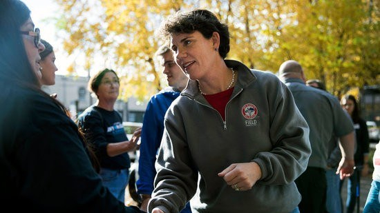 Amy McGrath, a Democratic House candidate, greets a supporter outside her campaign office in Lexington, Ky., on Monday, Nov. 5, 2018. (Maddie McGarvey/The New York Times)