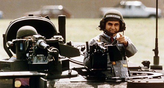 **FOR USE WITH AP LIFESTYLES** **FILE*** This Sept. 13, 1988 file photo shows Democratic Presidential candidate Michael Dukakis as he gets a free ride in one of General Dynamics' new M1-A-1 battle tanks at its land systems division in Sterling Heights, Mich. (AP Photo/Michael E. Samojeden, FILE)