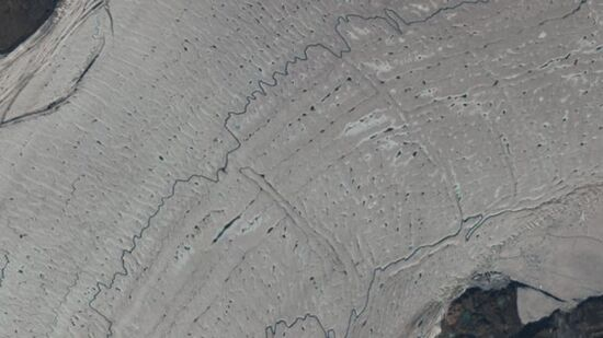 The trunk of N79 is covered in melt ponds and streams