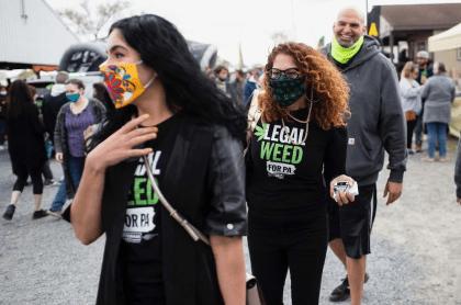 Gisele Fetterman, Celeste Trusty, and John Fetterman at the cannabis festival.