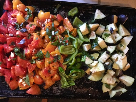 Toss veggies with oil & spread onto roasting pan