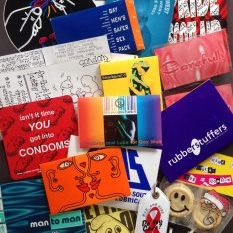 Assorted condom packaging from the archive. Photo: Siân Cook.