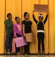 "Students at Burgess-Peterson present during ""A Passport Into Black History"". Photos courtesy of Burgess-Peterson Academy."
