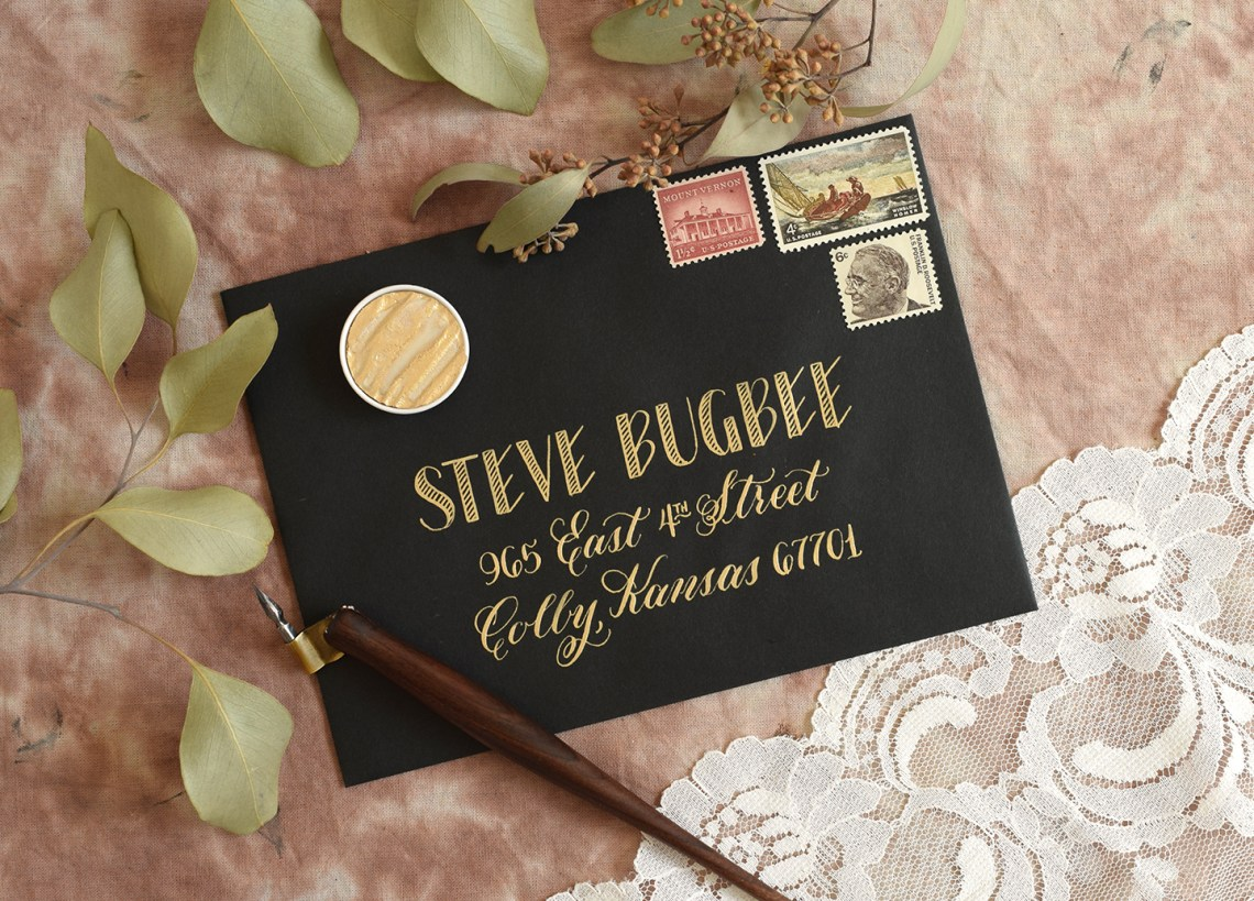Black Envelope with Gold Lettering | The Postman's Knock
