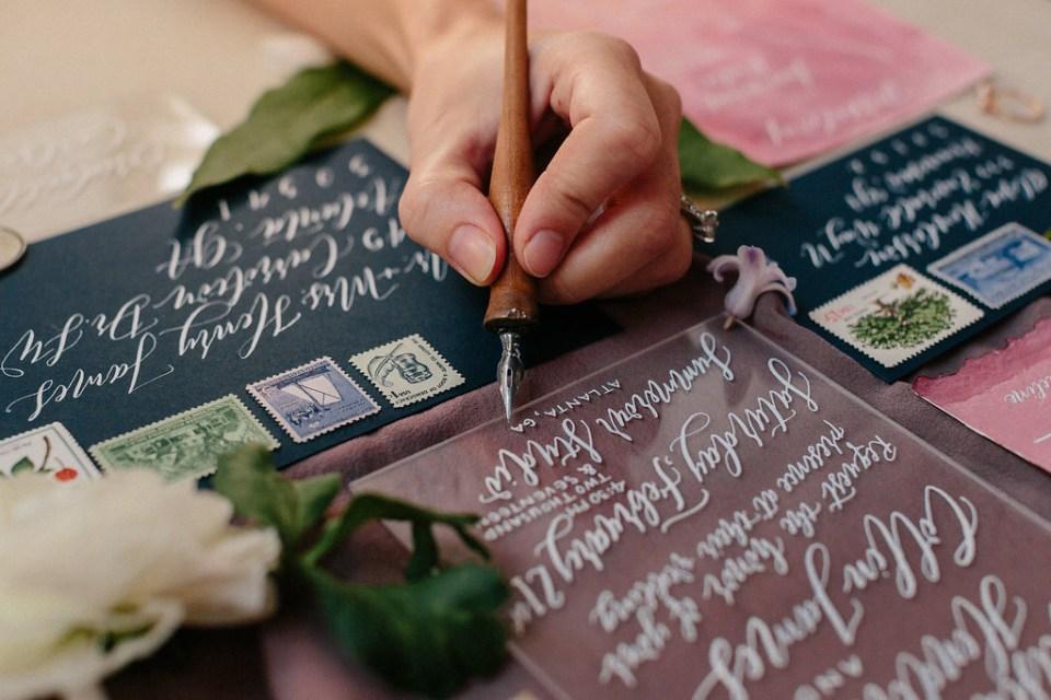 Photo of Lefty Calligrapher Elisabeth Young Writing