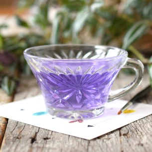 This lovely art water cup features a floral burst pattern!