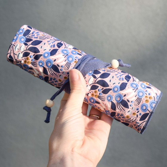 To take your supplies on the go, simply roll everything up and tie it shut!