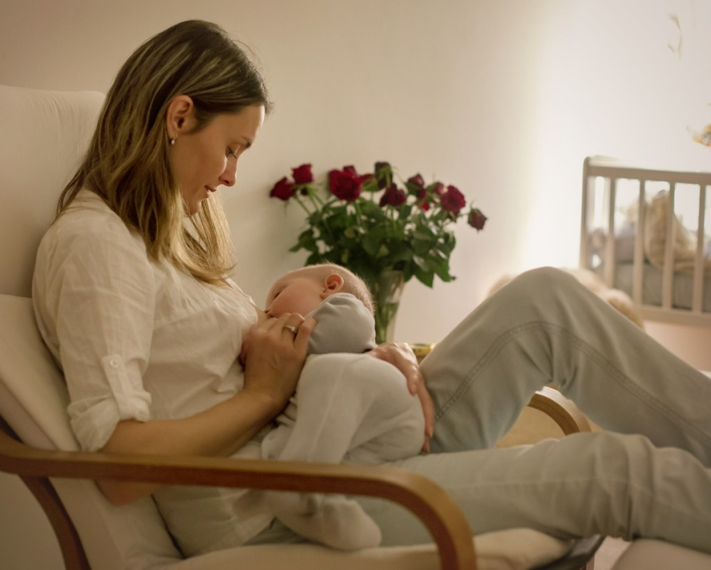 mom using a dream feed for baby to sleep through the night
