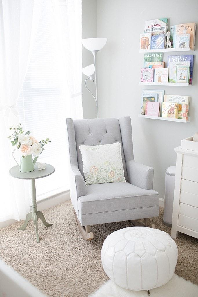 nursery organization with recliner and bookshelves