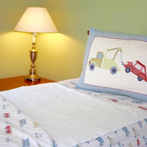 Twin bed shown with a Wet-Stop waterproof bedwetting pad in place.