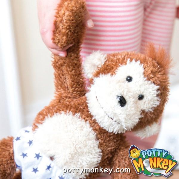 Potty Monkey talking plush doll for potty training.