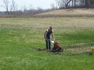 Jeff tilling up a garden spot.