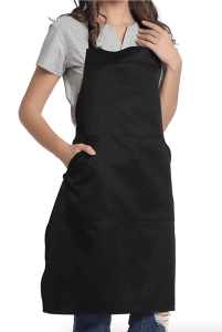 a woman wearing a black apron with extra long ties