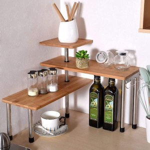 a three tier shelf that fits into the corner of a small kitchen space