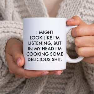 """a white mug that says """"i might look like i'm litening but in my head i'm cooking some delicious sh*t"""""""