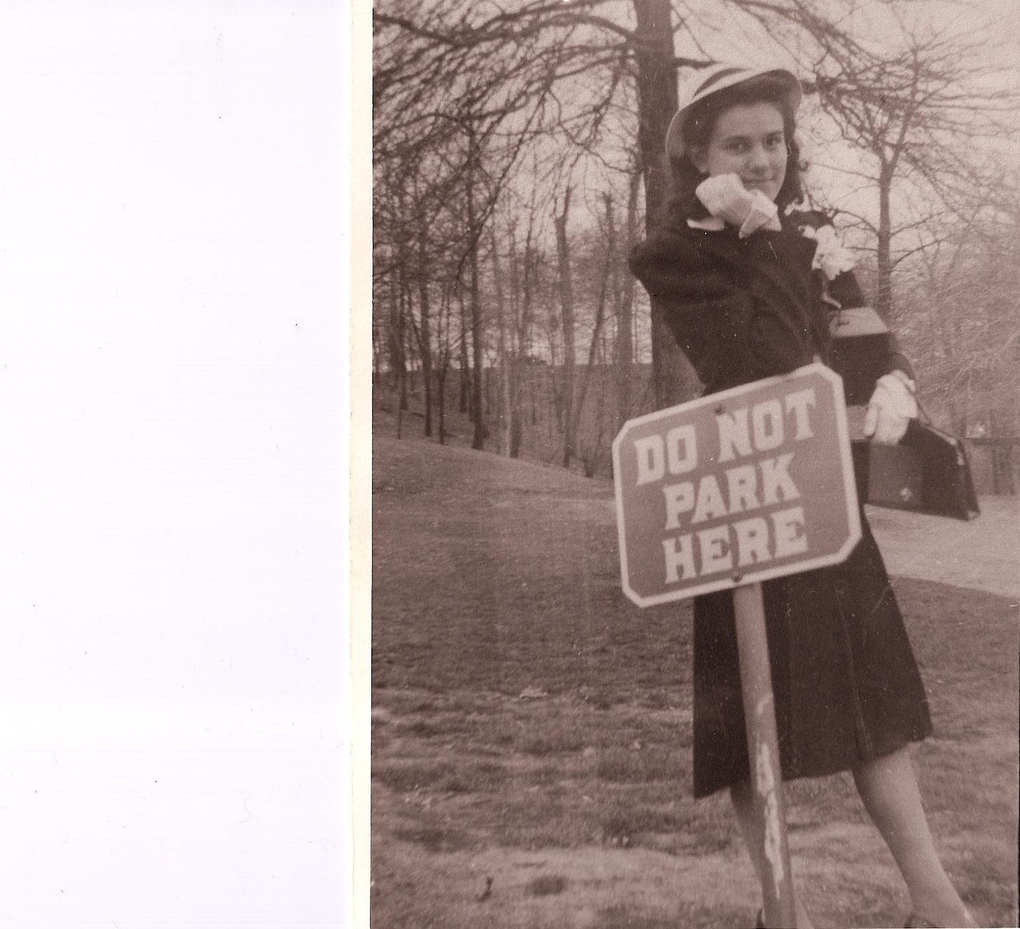 Mom at parking sign