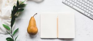 Pear and an open blank journal