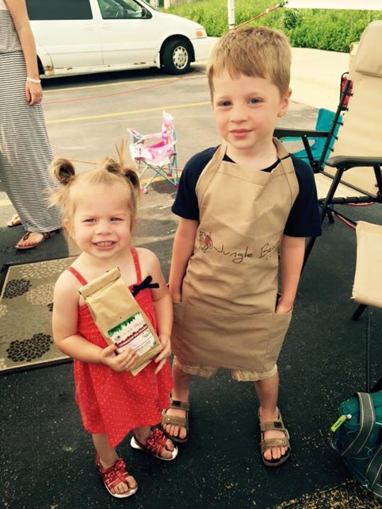 Jungle Beans kids with bag of locally roasted coffee