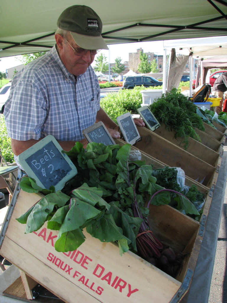 Bill Smith at Rosemont Valley Farms booth at the Prairie Farmers' Market
