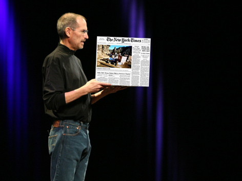 Steve Jobs holding a copy of newly-acquired New York Times