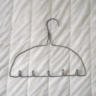 """There must be 101 ways we can use coat hangers, all over the house, yard, and vehicle. For preppers who can source them for free, they can be a particular goldmine. They're something to keep an eye out for, both now and in any """"later"""" circumstances."""