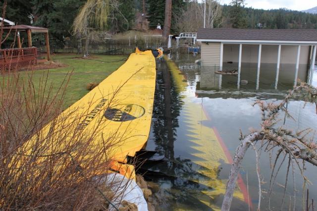 Flood wall defending a home