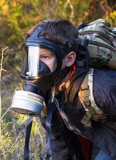 Child wearing one of the three top approved CBRN gas masks
