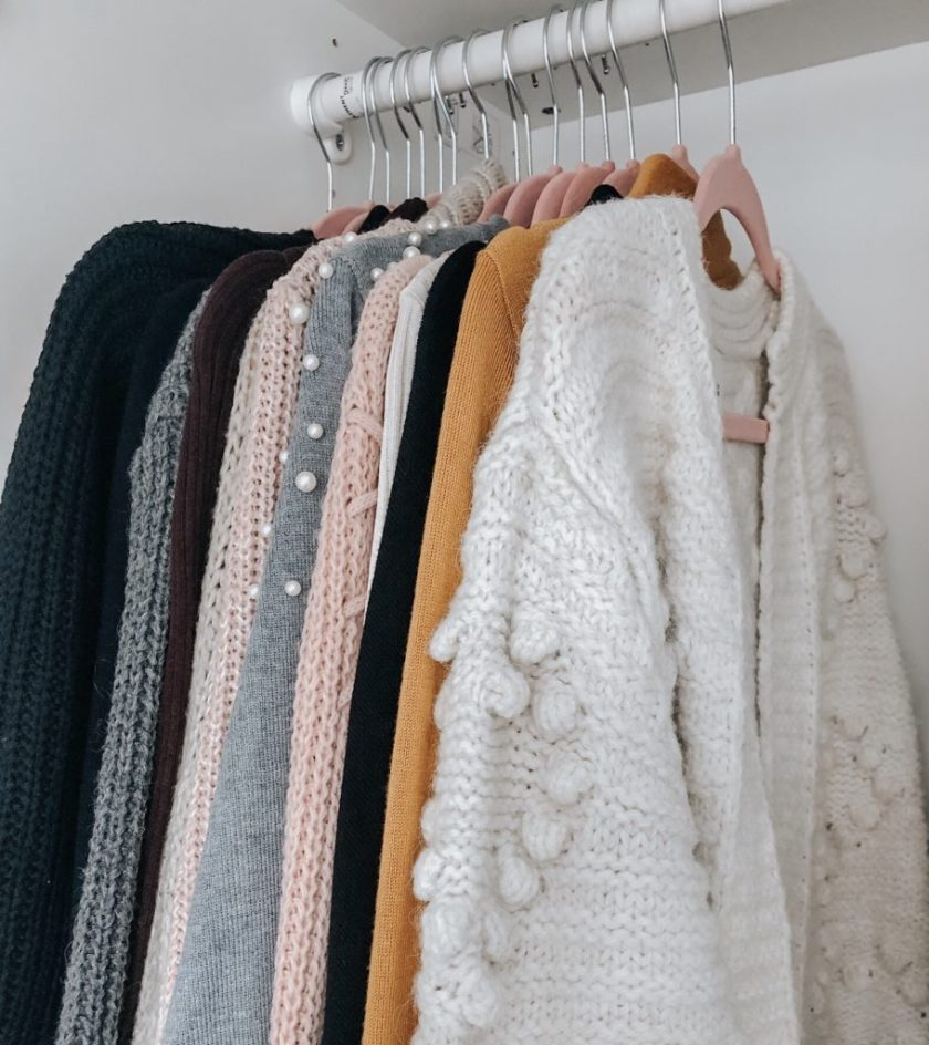 Winter jumpers hanging in my wardrobe
