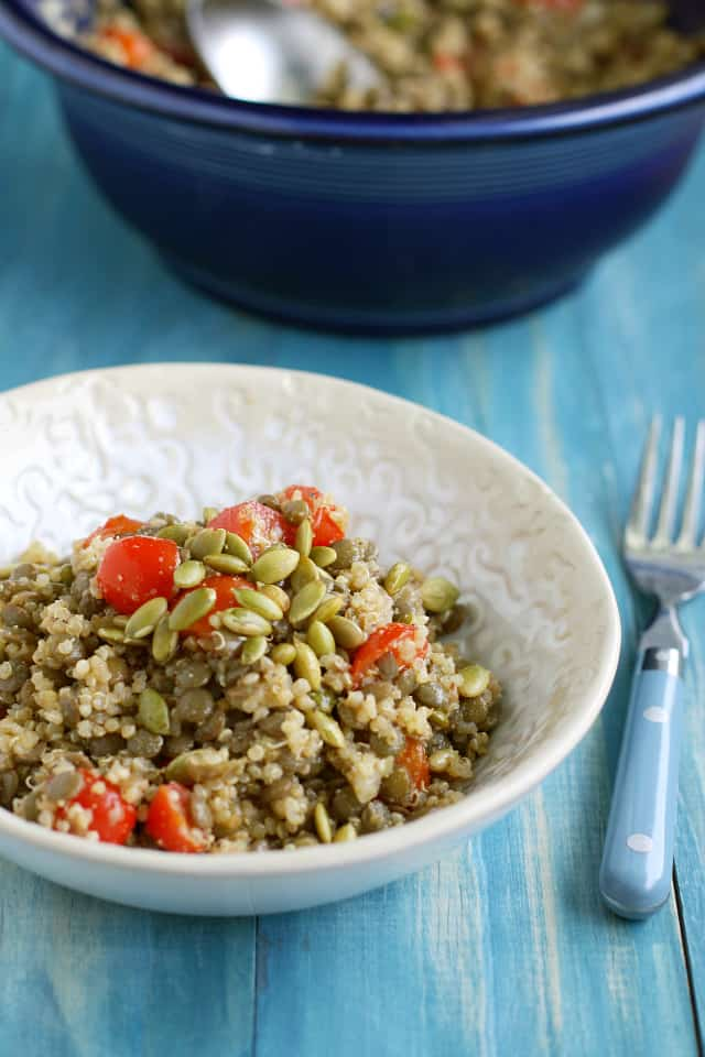 A fresh salad made with quinoa, lentils, tomatoes, and pepitas. #vegan #glutenfree #cleaneating
