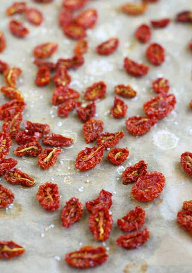 How to make oven dried cherry tomatoes. These little gems are bursting with summer flavor!