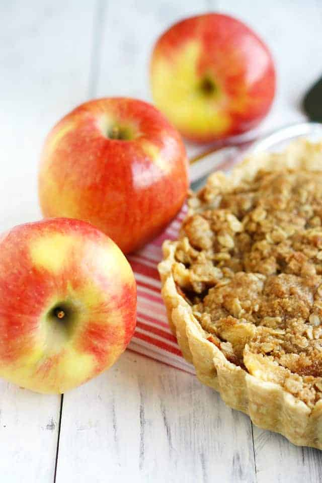 A delicious Ambrosia apple tart with a buttery crumble topping!