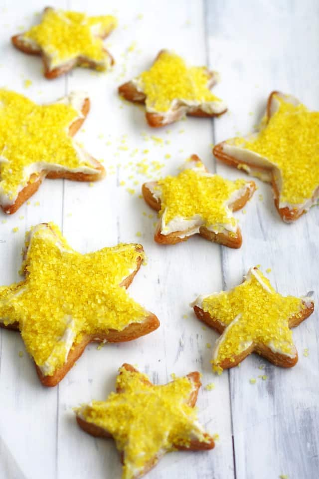 Festive and delicious vegan lemon frosted sugar cookie recipe. These work well with gluten free flour, too!