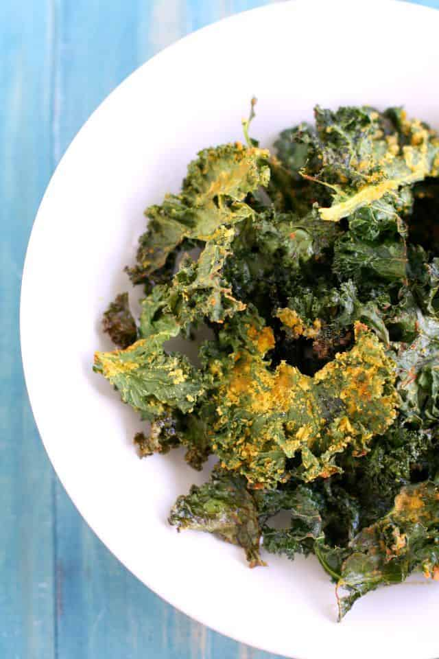 Crispy, cheesy, tasty baked kale chips. Easy and healthy vegan recipe.