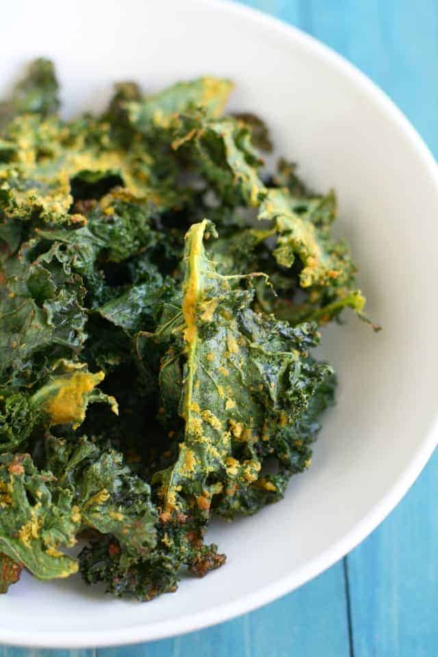 Vegan cheesy kale chip recipe. No nuts involved in this easy recipe!