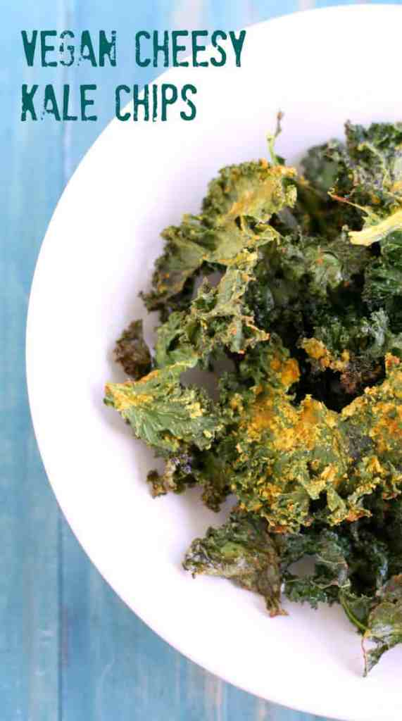 Light and crispy kale chips with a tasty vegan cheesy flavor! Yum! A perfect healthy snack.