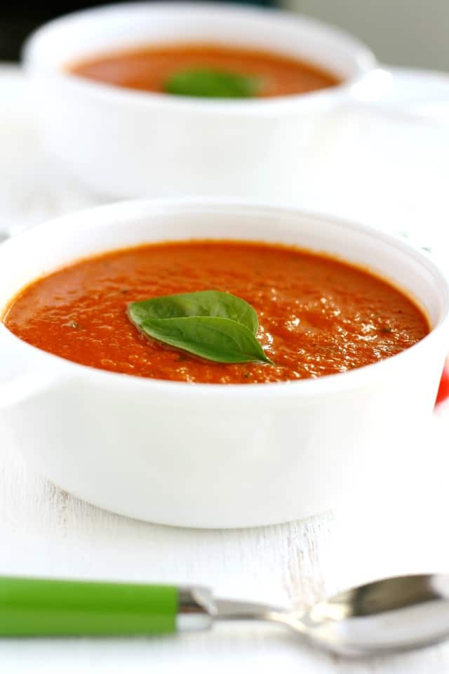 Rich, creamy tomato soup is full of flavor from garden fresh tomatoes, basil, and coconut milk. Delicious and comforting.