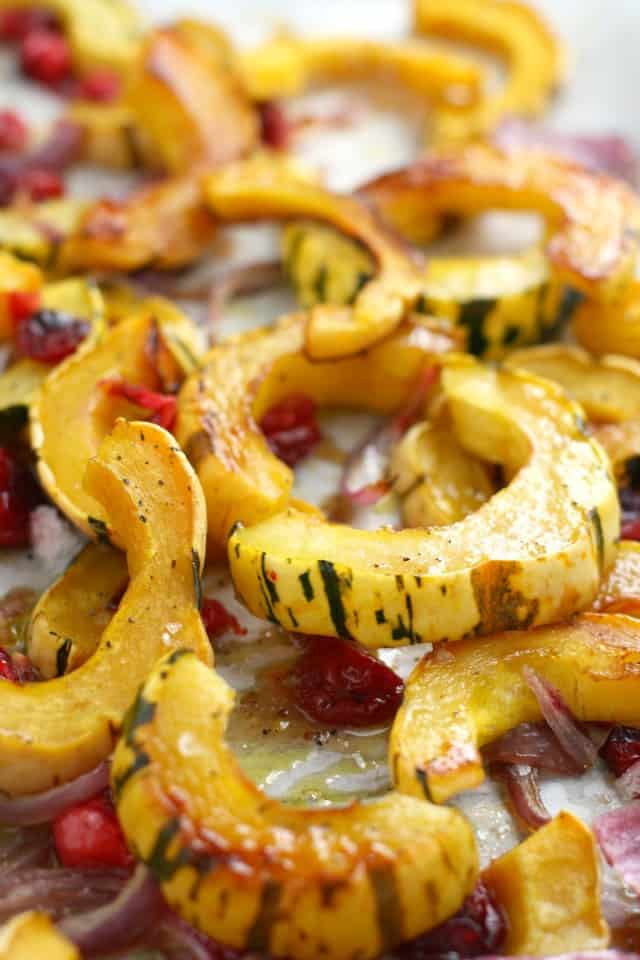 Delicata squash is so flavorful when roasted with red onions and cranberries and topped with a maple glaze. A great side for Thanksgiving! Healthy and easy.