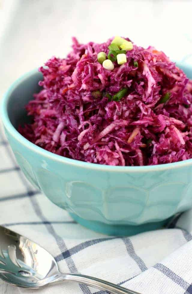 Simple red cabbage slaw with apples is sweet and tangy, and a terrific side dish!