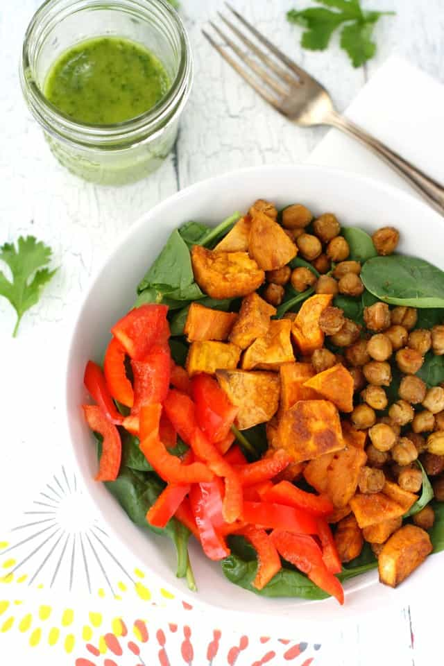 A healthy fall salad with roasted sweet potatoes, chickpeas, and cilantro vinaigrette. Vegan and gluten free.