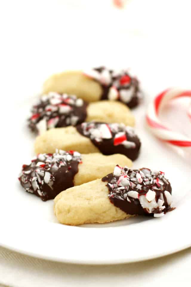 Buttery shortbread cookies are dipped in chocolate and candy canes for a festive treat!