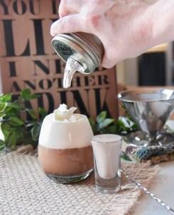 Coconut dairy-free Irish creamer shot and coconut whip cream.