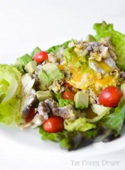Breakfast salad with soft yolk
