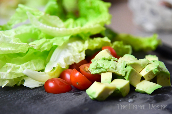 Breakfast salad prep: butter lettuce, cherry tomatoes, and cubed avocado