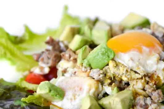 Breakfast salad, scrambled eggs and yolk
