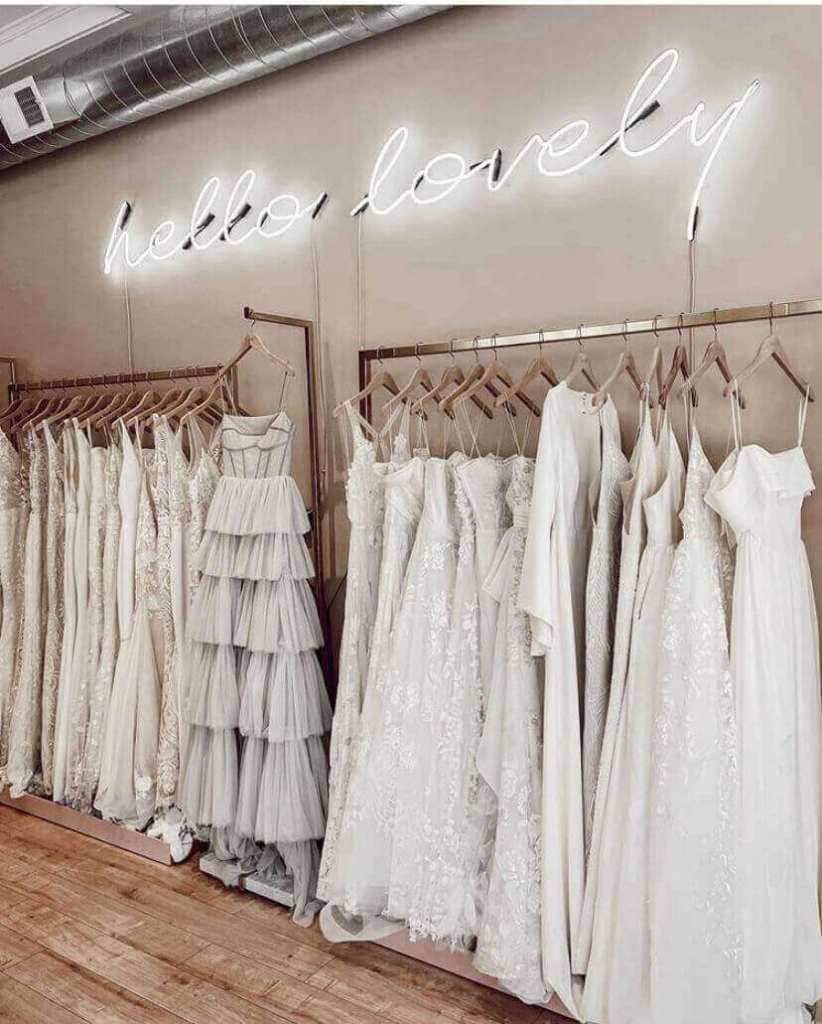 Row of wedding dresses in bridal shop