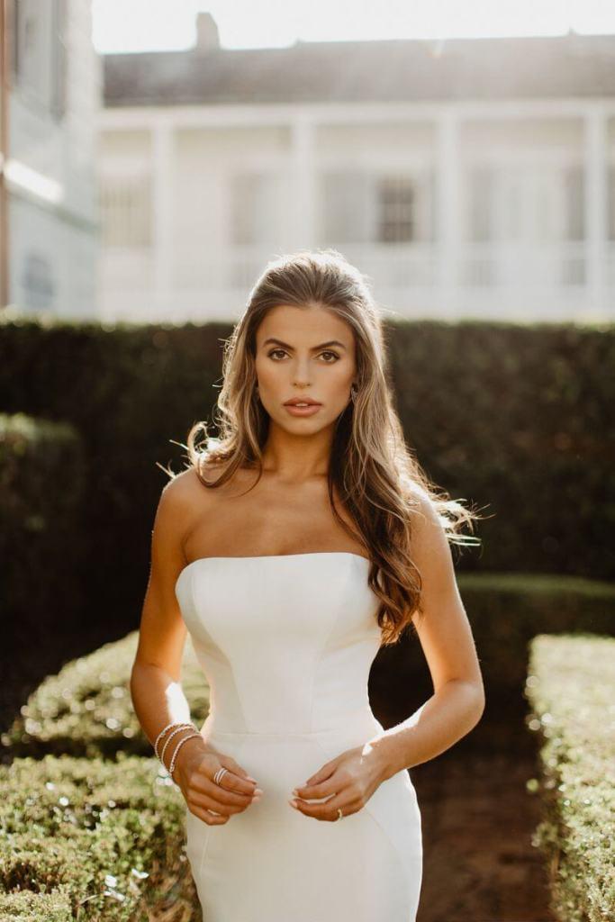 Brooks Nader posing in Louisiana at her wedding venue