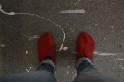 """I have designated a pair of """"studio vamps"""" that my mom knit me to keep my feet warm. I imagine most people wear shoes in the studio, but weavers are generally sock-footed."""